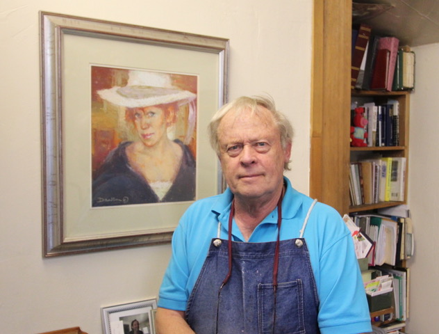 Doug Dawson stands next to his pastel painting of his wife, Sue, in their Wheat Ridge home.