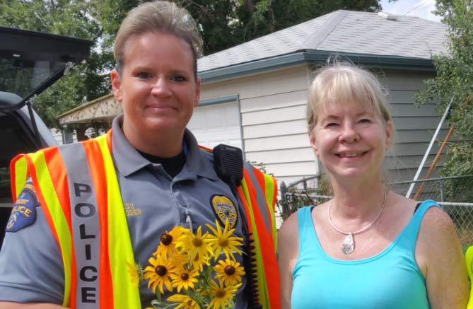 LocalWorks volunteers stand with a police officer
