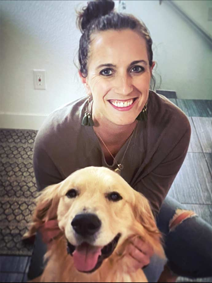Nicole Beaudin sits with her dog