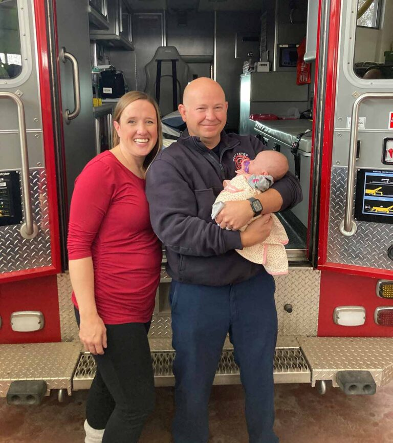 West Metro Firefighter/Paramedic Dennis Hollister holds a baby he delivered along with the mother